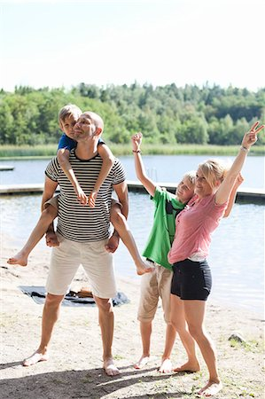 Happy Caucasian family enjoying together at beach Stock Photo - Premium Royalty-Free, Code: 698-06444530