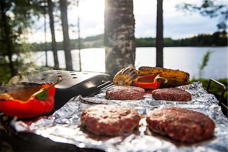 spicy - Meat, corn and bell pepper being grilled on barbecue Stock Photo - Premium Royalty-Free, Code: 698-06443681