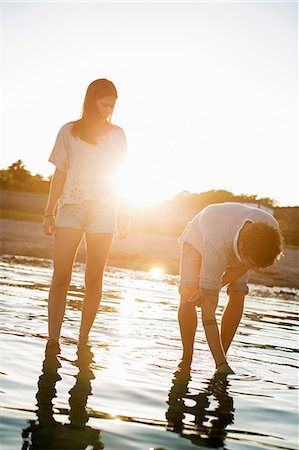 sun - Young couple spending time together in water at beach Stock Photo - Premium Royalty-Free, Code: 698-06443765