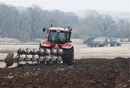 plow - Farmer plowing field in spring Stock Photo - Premium Royalty-Free, Code: 698-06443873