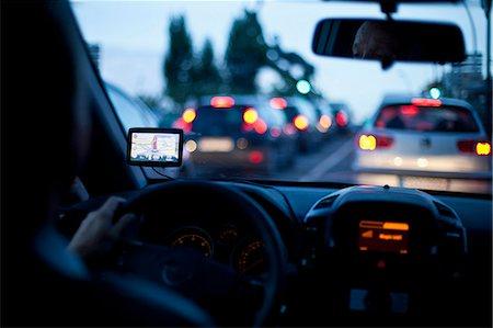 Person using navigator inside car during road trip Stock Photo - Premium Royalty-Free, Code: 698-06443923