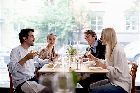 restaurant - Group of happy friends at restaurant table Stock Photo - Premium Royalty-Free, Code: 698-06443956