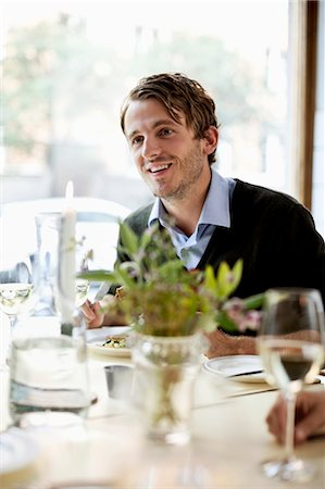 enjoying - Young man looking away at restaurant table Stock Photo - Premium Royalty-Free, Code: 698-06443957