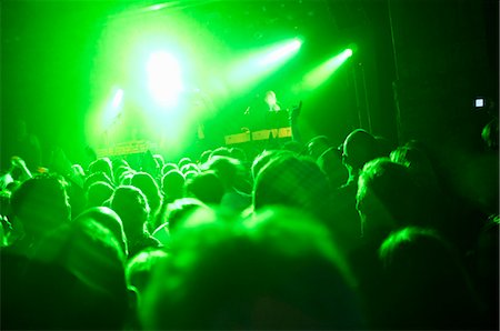 Rays of green lights over crowded dance floor at nightclub Stock Photo - Premium Royalty-Free, Code: 698-06615369