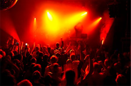 Rays of red spotlights over crowded dance floor at nightclub Stock Photo - Premium Royalty-Free, Code: 698-06615370