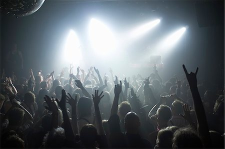Rays of white spotlights over crowded dance floor at nightclub Stock Photo - Premium Royalty-Free, Code: 698-06615372