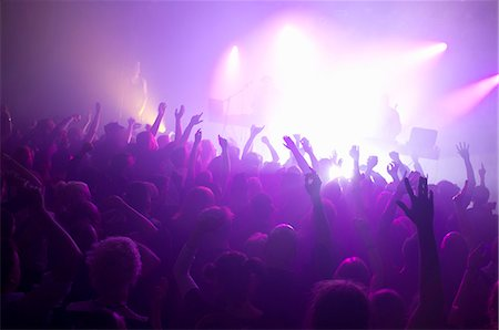 Rays of purple spotlights over crowded dance floor at nightclub Stock Photo - Premium Royalty-Free, Code: 698-06615373