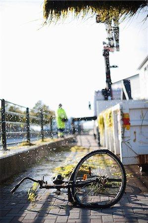 Broken bicycle wheel on pavement Stock Photo - Premium Royalty-Free, Code: 698-06615494