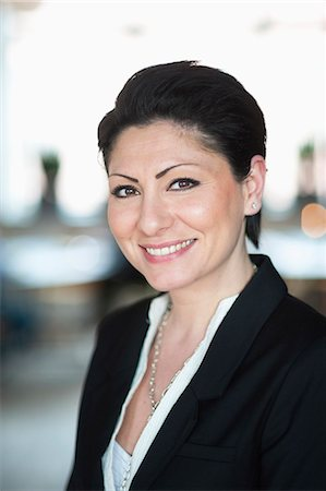 short hair - Portrait of happy mid adult businesswoman Stock Photo - Premium Royalty-Free, Code: 698-06615559