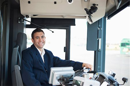 Portrait of happy mid adult bus driver Stock Photo - Premium Royalty-Free, Code: 698-06615648