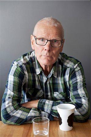 Portrait of senior man at table Stock Photo - Premium Royalty-Free, Code: 698-06615687