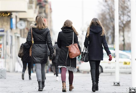 Rear view of women walking on street Stock Photo - Premium Royalty-Free, Code: 698-06615859