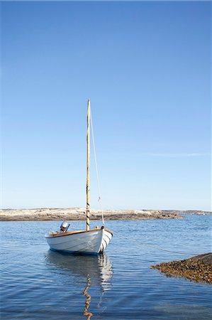 sailboat  ocean - Nautical vessel moored in sea against sky Stock Photo - Premium Royalty-Free, Code: 698-06615873
