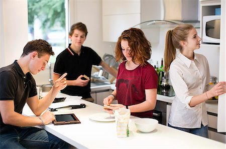 fridge - Young friends in domestic kitchen Stock Photo - Premium Royalty-Free, Code: 698-06615950