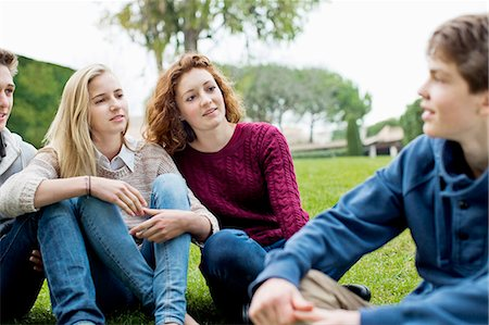 Teenage friends sitting together in park Stock Photo - Premium Royalty-Free, Code: 698-06615970