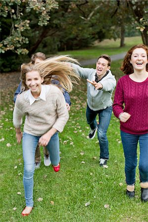 Cheerful young friends playing at park Stock Photo - Premium Royalty-Free, Code: 698-06615981