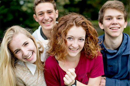 Portrait of happy young friends at park Stock Photo - Premium Royalty-Free, Code: 698-06615983