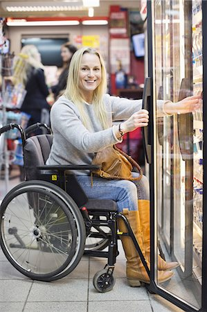 fridge - Portrait of happy disabled woman in wheelchair at refrigerated section of supermarket Stock Photo - Premium Royalty-Free, Code: 698-06616020