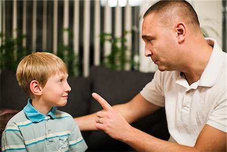 preteens fingering - Angry mid adult man disciplining son at home Stock Photo - Premium Royalty-Free, Code: 698-06616052