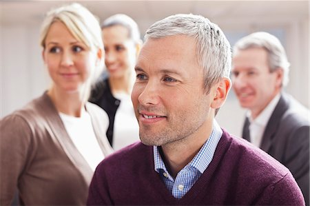 Business people looking away at office Stock Photo - Premium Royalty-Free, Code: 698-06616062