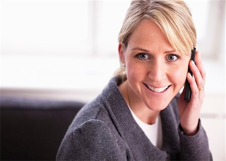 Happy mid adult businesswoman on call Stock Photo - Premium Royalty-Free, Code: 698-06616076