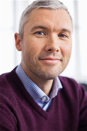 Portrait of mature businessman smiling Stock Photo - Premium Royalty-Free, Code: 698-06616072