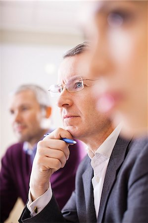 Businessman with colleagues in a meeting Stock Photo - Premium Royalty-Free, Code: 698-06616085