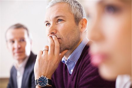 Mature businessman with colleagues in a meeting Stock Photo - Premium Royalty-Free, Code: 698-06616086