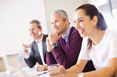 Happy business people in a meeting Stock Photo - Premium Royalty-Free, Code: 698-06616087