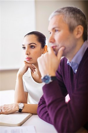 Concentrated business woman with colleague in a meeting Stock Photo - Premium Royalty-Free, Code: 698-06616081