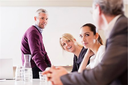 Group of business people at table in a meeting Stock Photo - Premium Royalty-Free, Code: 698-06616099