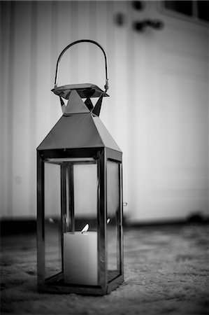 Old-fashioned lantern with lit candle on snow Stock Photo - Premium Royalty-Free, Code: 698-06616115