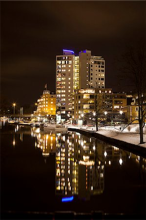 Reflection of illuminated buildings in lake at night Stock Photo - Premium Royalty-Free, Code: 698-06616125