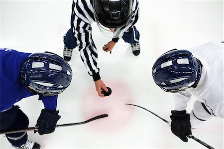 sports and hockey - Directly above shot of referee and two ice hockey players in face-off Stock Photo - Premium Royalty-Free, Code: 698-06616152