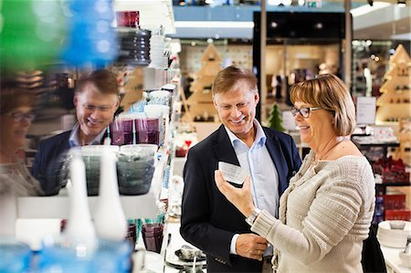 shopping mall - Happy senior couple buying kitchenware in shopping mall Stock Photo - Premium Royalty-Free, Code: 698-06616229