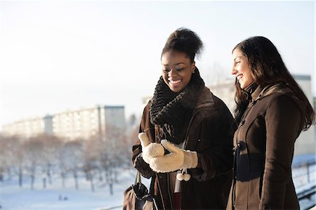 Happy young female friends in warm clothing Stock Photo - Premium Royalty-Free, Code: 698-06616237