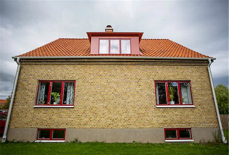 Exterior of house against cloudy sky Stock Photo - Premium Royalty-Free, Code: 698-06804147
