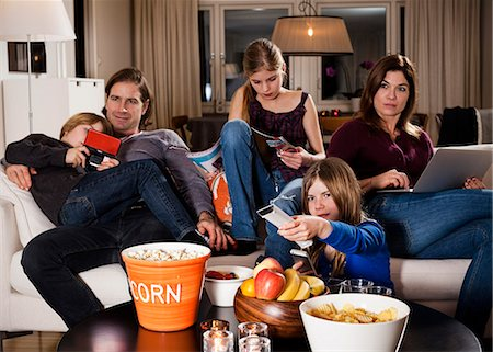 Family spending leisure time in living room Stock Photo - Premium Royalty-Free, Code: 698-06804154