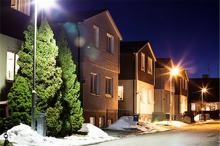 View of houses in a row during winter at night Stock Photo - Premium Royalty-Free, Code: 698-06966245