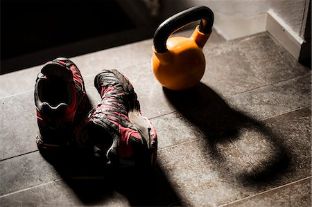 High angle view of kettlebell and sports shoes on table Stock Photo - Premium Royalty-Free, Code: 698-06966255