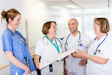 Happy male and female doctors laughing in hospital Stock Photo - Premium Royalty-Free, Code: 698-06966363