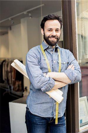 portrait smile caucasian one - Portrait of confident mid adult male designer standing arms crossed at studio doorway Stock Photo - Premium Royalty-Free, Code: 698-06966438