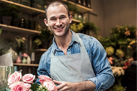 florist - Portrait of happy male florist standing with flowers at shop Stock Photo - Premium Royalty-Free, Code: 698-06966464