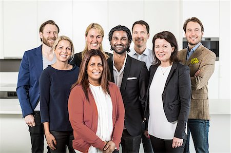 Portrait of multi-ethnic business people standing together in office Stock Photo - Premium Royalty-Free, Code: 698-06966536