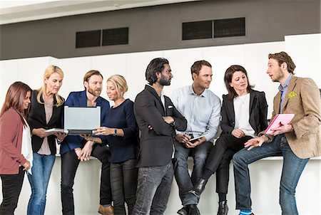 Multi-ethnic group of business people discussing in office Stock Photo - Premium Royalty-Free, Code: 698-06966538