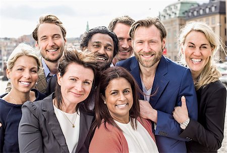 Portrait of happy multi-ethnic business people standing together outdoors Stock Photo - Premium Royalty-Free, Code: 698-06966553
