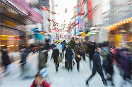 Blurred motion of crowd walking on city street during rush hour Stock Photo - Premium Royalty-Free, Code: 698-06966745