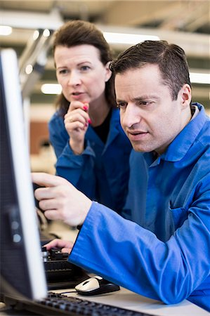 Technicians working on Desktop PC together in industry Stock Photo - Premium Royalty-Free, Code: 698-06966891