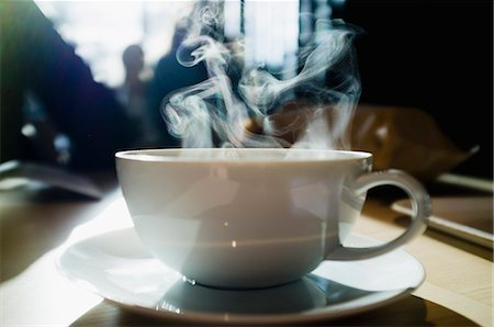 europe coffee shop - Coffee cup with steam coming out Stock Photo - Premium Royalty-Free, Code: 698-07158466
