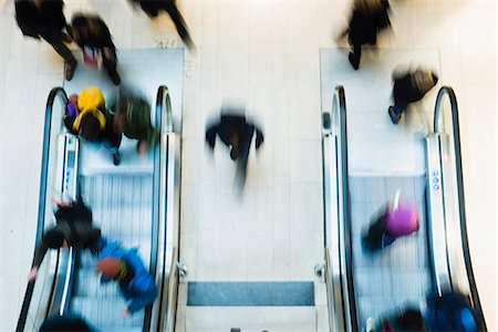 Blurred motion of people using escalator in mall Stock Photo - Premium Royalty-Free, Code: 698-07158461